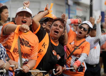 Supporters of opposition leader Keiko Fujimori celebrate outside the Santa Mónica women's prison before her release in Lima, Peru, . The Constitutional Tribunal narrowly approved a habeas corpus request to free Fujimori from detention while she is investigated for alleged accusations she accepted money from Brazilian construction giant Odebrecht