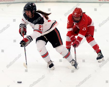 Stock Picture of Ohio State Buckeyes forward Liz Schepers (21) fights for the puck against Cornell Big Red forward Maddie Mills (22) in their game in Columbus, Ohio