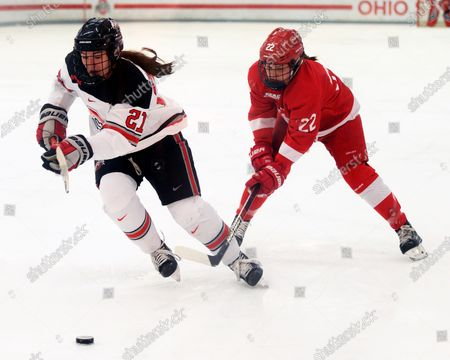 Ohio State Buckeyes forward Liz Schepers (21) fights for the puck against Cornell Big Red forward Maddie Mills (22) in their game in Columbus, Ohio