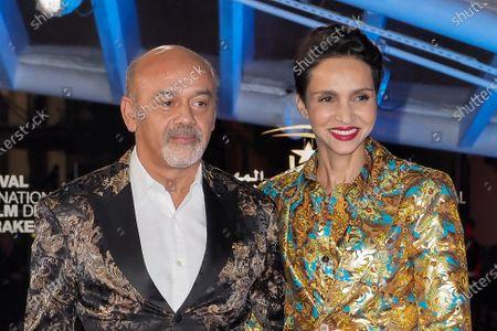 Stock Image of Christian Louboutin and Farida Khelfa