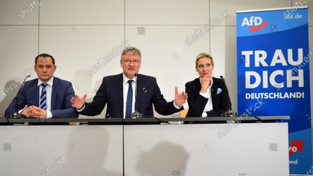 The two newly elected co-chairmen Tino Chrupalla (L) and Joerg Meuthen (C) and  the newly elected deputy chairwoman Alice Weidel (R) during a press conference at the party convention of the German right-wing 'Alternative for Germany' ('Alternative fuer Deutschland' AfD) in Braunschweig, northern Germany 30 November 2019. The AfD holds its convention in Brunswick on 30 November and 01 December.