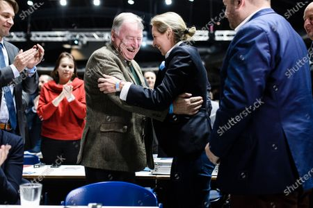 Stock Image of Alternative for Germany party (AfD) faction co-chairwoman in the German parliament Bundestag and observer at the federal chair board Alice Weidel (C-R) receives congratulations by former Alternative for Germany party (AfD) co-chairman Alexander Gauland (C-L) after Weidel was elected for deputy chair during the party convention of the German right-wing 'Alternative for Germany' ('Alternative fuer Deutschland' AfD) in Braunschweig, northern Germany 30 November 2019. The AfD holds its convention in Brunswick on 30 November and 01 December.