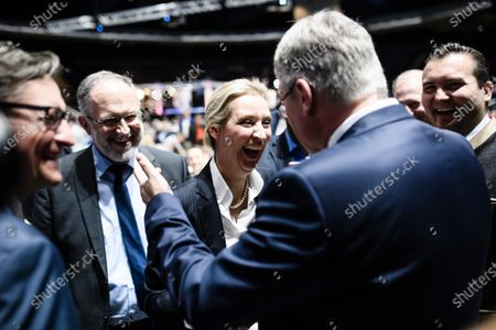 Stock Photo of Alternative for Germany party (AfD) faction co-chairwoman in the German parliament Bundestag and observer at the federal chair board Alice Weidel (C-L) receives congratulations by newly re-elected co-chairman Joerg Meuthen after Weidel was elected for deputy chair during the party convention of the German right-wing 'Alternative for Germany' ('Alternative fuer Deutschland' AfD) in Braunschweig, northern Germany 30 November 2019. The AfD holds its convention in Brunswick on 30 November and 01 December.