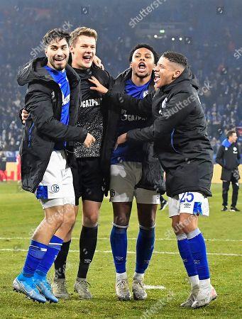 Schalke's Weston McKennie, Amine Harit, Alexander Nuebel, Suat Serdar, from right, celebrate after winning the German Bundesliga soccer match between FC Schalke 04 and Union Berlin in Gelsenkirchen, Germany, . Schalke defeated Union with 2-1