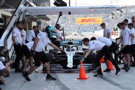 Mercedes driver Valtteri Bottas of Finland gets a pit service during the third free practice at the Yas Marina racetrack in Abu Dhabi, United Arab Emirates, . The Emirates Formula One Grand Prix will take place on Sunday