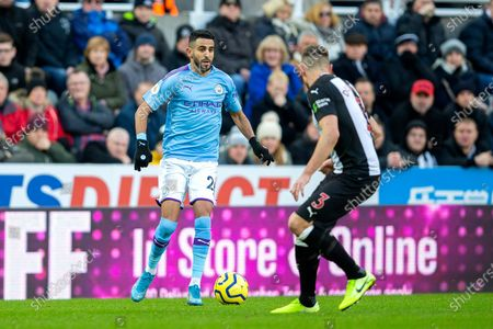 Riyad Mahrez (#26) of Manchester City looks to take on Paul Dummett (#3) of Newcastle United during the Premier League match between Newcastle United and Manchester City at St. James's Park, Newcastle