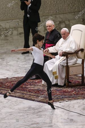Stock Picture of Pope Francis (R) looks on as a young dancer, Jorge Garcia Lamelas, performs during an audience of the 'Design for Change' group in Vatican, 30 November 2019. 'Design for Change', DFC, is a world-wide movement of change - by and of children. The movement is active in 44 countries and impacts the lives of more than 65,000 teachers and some 2.2 million children.