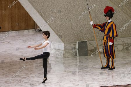 Stock Photo of Young dancer, Jorge Garcia Lamelas (L), performs during an audience of the 'Design for Change' group in front of Pope Francis (unseen) in Vatican, 30 November 2019. 'Design for Change', DFC, is a world-wide movement of change - by and of children. The movement is active in 44 countries and impacts the lives of more than 65,000 teachers and some 2.2 million children.