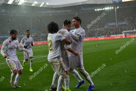 Dani Carvajal, Sergio Rams, Marcelo. Real Madrid's Dani Carvajal, second right, celebrates with teammates Sergio Ramos, right, and Marcelo after scoring his side's second goal during the Spanish La Liga soccer match between Real Madrid and Alaves at Mendizorroza stadium, in Vitoria, northern Spain
