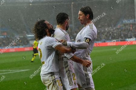 Dani Carvajal, Sergio Rams, Marcelo. Real Madrid's Dani Carvajal, center, celebrates with teammates Sergio Ramos, right, and Marcelo after scoring his side's second goal of the game during the Spanish La Liga soccer match between Real Madrid and Alaves at Mendizorroza stadium, in Vitoria, northern Spain