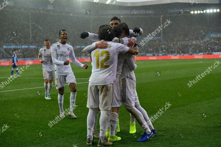 Stock Photo of Dani Carvajal, Sergio Rams, Marcelo. Real Madrid's Dani Carvajal, center, celebrates with teammates Sergio Ramos and Marcelo after scoring his side's second goal of the game during the Spanish La Liga soccer match between Real Madrid and Alaves at Mendizorroza stadium, in Vitoria, northern Spain