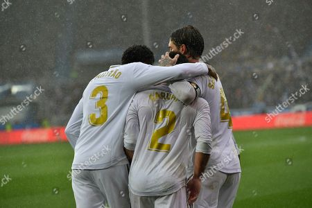 Stock Picture of Dani Carvajal, Sergio Ram0s, Eder Militao. Real Madrid's Dani Carvajal, center, celebrates with teammates Sergio Ramos, right, and Eder Militao after scoring his side's second goal of the game during the Spanish La Liga soccer match between Real Madrid and Alaves at Mendizorroza stadium, in Vitoria, northern Spain