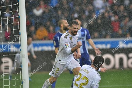Real Madrid's Dani Carvajal celebrates scoring his side's second goal of the game during the Spanish La Liga soccer match between Real Madrid and Alaves at Mendizorroza stadium, in Vitoria, northern Spain
