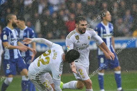 Real Madrid's Dani Carvajal, center, celebrates scoring his side's second goal of the game during the Spanish La Liga soccer match between Real Madrid and Alaves at Mendizorroza stadium, in Vitoria, northern Spain