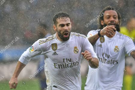 Dani Carvajal, Marcelo. Real Madrid's Dani Carvajal, left, celebrates scoring his side's second goal with teammate Marcelo during the Spanish La Liga soccer match between Real Madrid and Alaves at Mendizorroza stadium, in Vitoria, northern Spain
