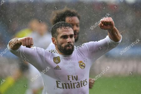 Real Madrid's Dani Carvajal, celebrates scoring his side's second goal during the Spanish La Liga soccer match between Real Madrid and Alaves at Mendizorroza stadium, in Vitoria, northern Spain