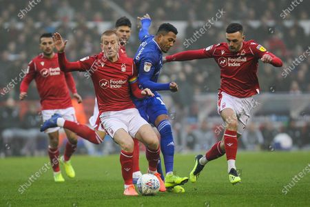 Ben Watson & Jack Robinson of Nottingham Forest, Nathaniel Mendez-Laing of Cardiff City during the EFL Sky Bet Championship match between Nottingham Forest and Cardiff City at the City Ground, Nottingham