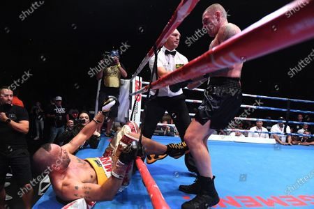 Australia's Anthony Mundine (L) and John-Wayne Parr fight during the 'Worlds Collide' boxing event at the Brisbane Convention and Exhibition Centre in Brisbane, Queensland, Australia, 30 November 2019. Mundine has lost by a majority split decision to Parr.