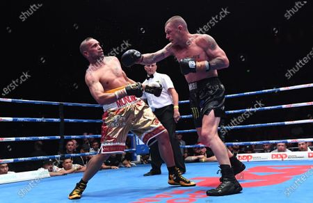 Stock Image of Australia's Anthony Mundine (L) and John-Wayne Parr fight during the 'Worlds Collide' boxing event at the Brisbane Convention and Exhibition Centre in Brisbane, Queensland, Australia, 30 November 2019. Mundine has lost by a majority split decision to Parr.