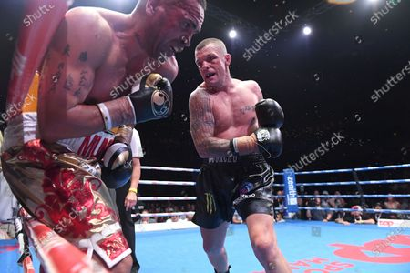 Stock Photo of Australia's Anthony Mundine (L) and John-Wayne Parr fight during the 'Worlds Collide' boxing event at the Brisbane Convention and Exhibition Centre in Brisbane, Queensland, Australia, 30 November 2019. Mundine has lost by a majority split decision to Parr.