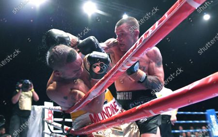 Stock Picture of Australia's John-Wayne Parr (R) strikes Anthony Mundine on the ropes during the 'Worlds Collide' boxing event at the Brisbane Convention and Exhibition Centre in Brisbane, Queensland, Australia, 30 November 2019. Mundine has lost by a majority split decision to Parr.