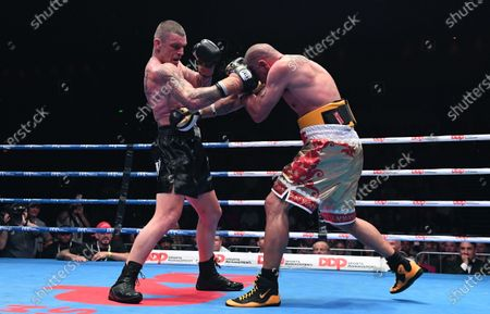 Australia's Anthony Mundine (R) and John-Wayne Parr fight during the 'Worlds Collide' boxing event at the Brisbane Convention and Exhibition Centre in Brisbane, Queensland, Australia, 30 November 2019. Mundine has lost by a majority split decision to Parr.
