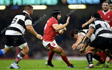 Leigh Halfpenny of Wales looks for a way through.