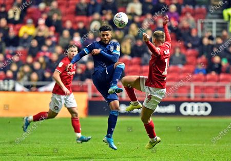 Elias Kachunga (9) of Huddersfield Town battles for possession with Andreas Weimann (14) of Bristol City during the EFL Sky Bet Championship match between Bristol City and Huddersfield Town at Ashton Gate, Bristol