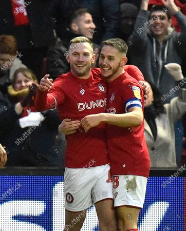 Stock Image of Goal - Andreas Weimann (14) of Bristol City  celebrates after he scores a goal to make the score 5-1 with Josh Brownhill (8) of Bristol City during the EFL Sky Bet Championship match between Bristol City and Huddersfield Town at Ashton Gate, Bristol