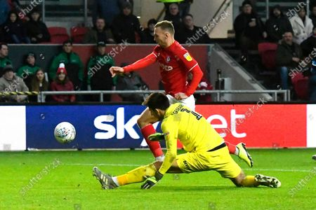Stock Photo of Goal - Andreas Weimann (14) of Bristol City  rounds Kamil Grabara (1) of Huddersfield Town to score a goal to make the score 5-1 during the EFL Sky Bet Championship match between Bristol City and Huddersfield Town at Ashton Gate, Bristol