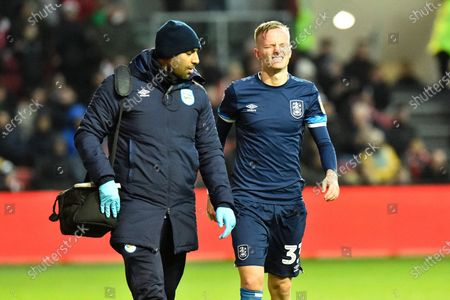 Florent Hadergjonaj (33) of Huddersfield Town in some pain after failing to stop Andreas Weimann (14) of Bristol City from scoring a goal to make the score 5-1 during the EFL Sky Bet Championship match between Bristol City and Huddersfield Town at Ashton Gate, Bristol