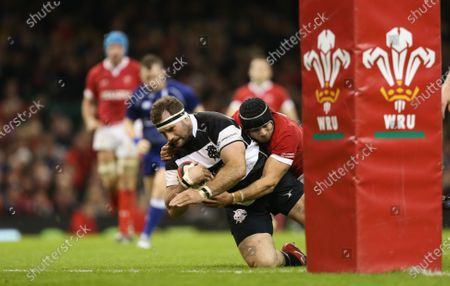 Stock Picture of Craig Millar of Barbarians beats Leigh Halfpenny of Wales as he scores try