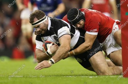 Craig Millar of Barbarians beats Leigh Halfpenny of Wales as he scores try