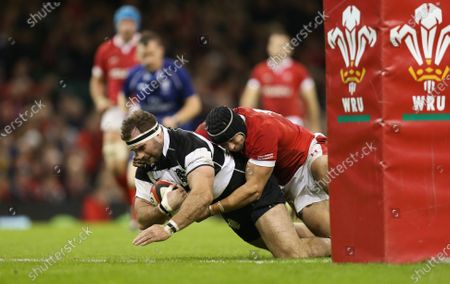 Stock Image of Craig Millar of Barbarians beats Leigh Halfpenny of Wales as he scores try