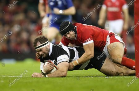 Stock Photo of Craig Millar of Barbarians beats Leigh Halfpenny of Wales as he scores try