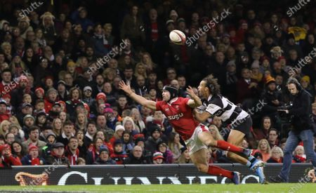 Leigh Halfpenny of Wales tangles with Dillyn Leyds of Barbarians allowing Shaun Stevenson of Barbarians to eventually race in to score try