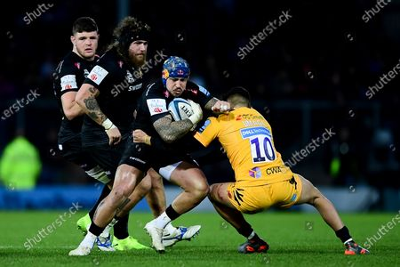 Jack Nowell of Exeter Chiefs is tackled by Jacob Umaga of Wasps