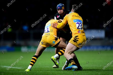 Jack Nowell of Exeter Chiefs is tackled by Marcus Watson of Wasps and Sam Spink of Wasps