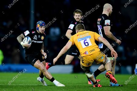 Jack Nowell of Exeter Chiefs is challenged by Jack Willis of Wasps