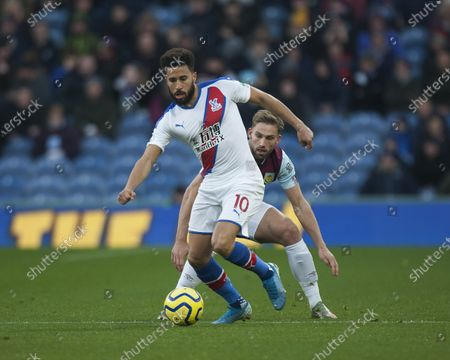 Andros Townsend of Crystal Palace (L) and Charlie Taylor of Burnley in action