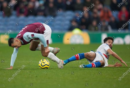 Dwight McNeil of Burnley (L) gets away from Andros Townsend of Crystal Palace