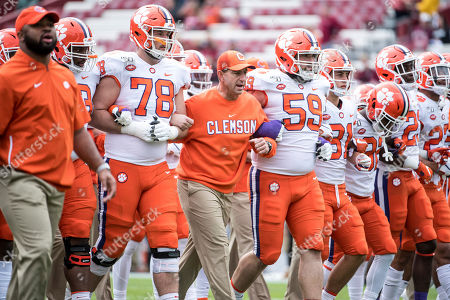 Dabo Swinney, Chandler Reeves, Gage Cervenka. Clemson head coach Dabo Swinney, lineman Chandler Reeves (78) and Gage Cervenka (59) walk across the field before an NCAA college football game against South Carolina, in Columbia, S.C. Clemson defeated South Carolina 38-3