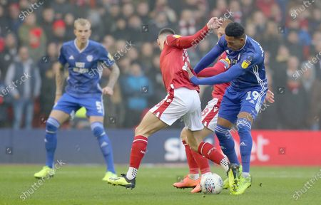 Nathaniel Mendez-Laing of Cardiff tussles with Ben Watson of Nottingham Forest and Jack Robinson of Nottingham Forest