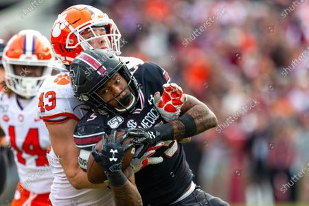 Stock Image of Clemson Tigers linebacker Chad Smith (43) cannot break up the catch by South Carolina Gamecocks running back Rico Dowdle (5) in the NCAA matchup at Williams-Brice Stadium in Columbia, SC