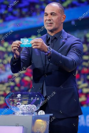Draw assistant, Former Dutch football player Ruud Gullit shows the ticket of the Netherlands during the UEFA EURO 2020 final draw in Bucharest, Romania, 30 November 2019.