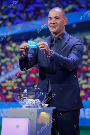 Draw assistant, Former Dutch football player Ruud Gullit shows the ticket of Switzerland during the UEFA EURO 2020 final draw in Bucharest, Romania, 30 November 2019.