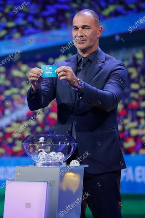 Draw assistant, Former Dutch football player Ruud Gullit shows the ticket of Russia during the UEFA EURO 2020 final draw in Bucharest, Romania, 30 November 2019.