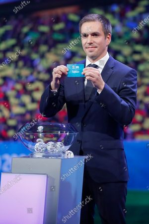 Draw assistant, Former German national soccer player Philipp Lahm shows the ticket of Turkey during the UEFA EURO 2020 final draw in Bucharest, Romania, 30 November 2019.
