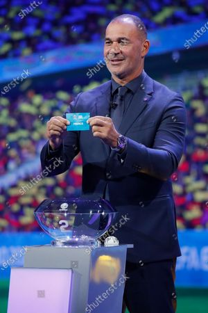 Draw assistant, Former Dutch football player Ruud Gullit shows the ticket of France during the UEFA EURO 2020 final draw in Bucharest, Romania, 30 November 2019.