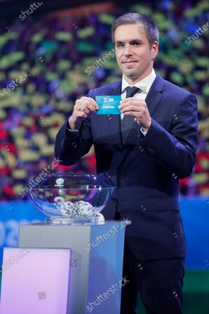Draw assistant, Former German national soccer player Philipp Lahm shows the ticket of Austria during the UEFA EURO 2020 final draw in Bucharest, Romania, 30 November 2019.